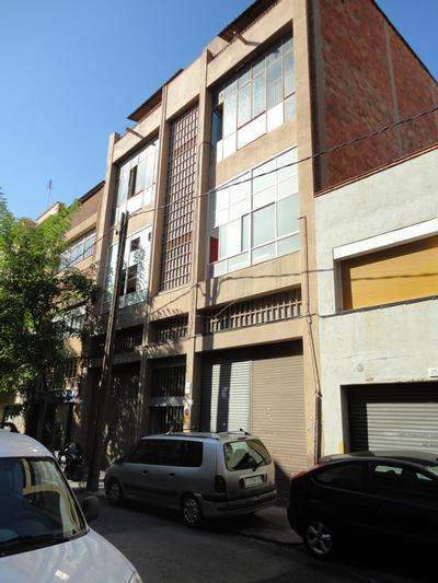 Fusteria de façana al C/. Coromina, nº 19 (Hospitalet de Llobregat)